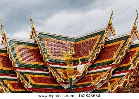 Thai art on roof Church at phathat Cheung choom woravihan templeSakol Nakon Thailand