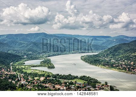 View from Ruin castle of Visegrad Hungary. Danube river. Travel destination. Sightseeing cruises. Forests clouds and flowing water.