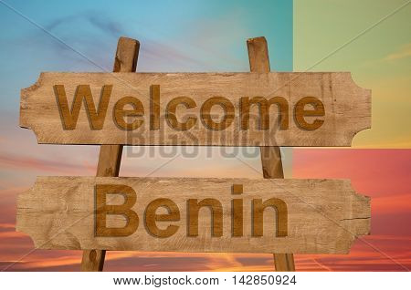 Welcome To  Benin Sing On Wood Background With Blending National Flag