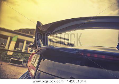 close up on sport car spioler, vintage effect