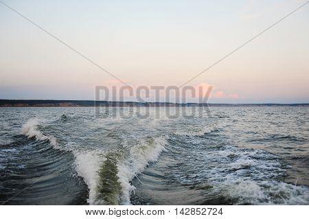 Summer sanset on the Volga river. Boat trip
