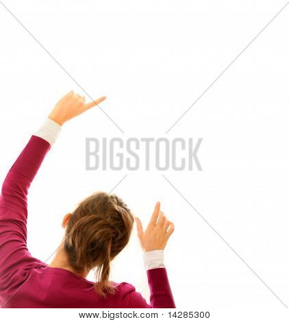 Young Woman Pointing At White Background