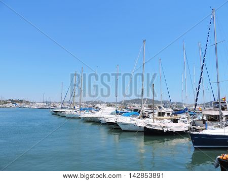 Yacht harbor with anchored ships and luxury boats.
