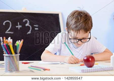 7 Years Old Boy Solves Multiplication Table In His Copybook.