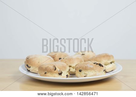 Scones Served On A White Plate