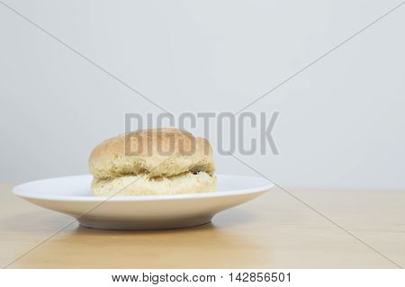 Scone Sitting On A White Plate