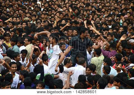 AMRAVATI, MAHARASHTRA, INDIA - AUGUST 24 : Crowd of young People enjoying