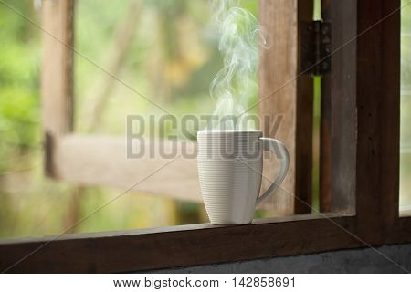 Hot Drink Coffee Cup With Smoke On Old Wooden Windows