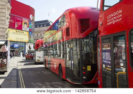 Buses Que Up At Lights In Piccadilly Circus