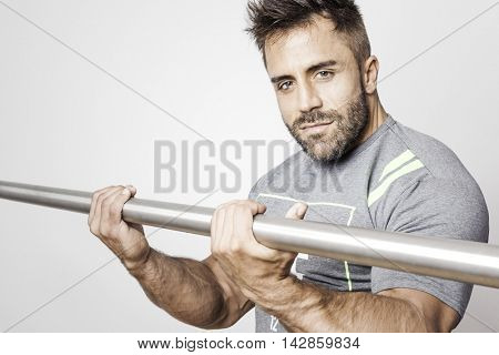 An image of a bearded bodybuilding man