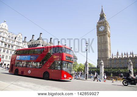 Red London Bus Passing Big Ben