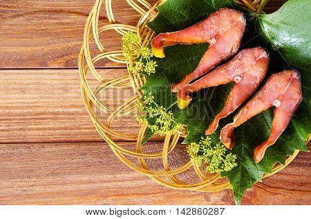 Salty red fish salmon trout on a plate wooden background
