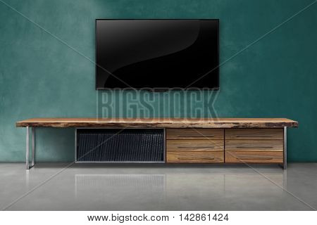 Tv On Color Concrete Wall With Wooden Table Interior Vintage Style