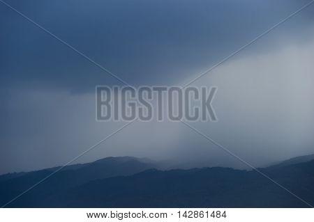 Very heavy rainfall on mountain evening. Impregnation dark black blemishes