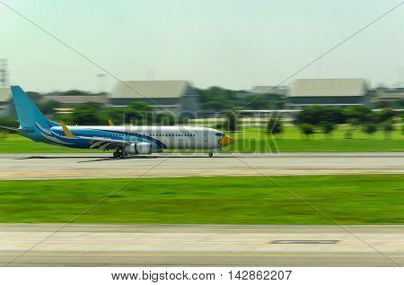 An air plane gradually landing ona long runway