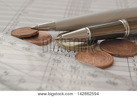 Business background with table ruler pens and money.