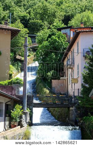 Varenna, Italy - June 20, 2016: Waterfall in village Varenna at Lake Como in Lombardy. Varenna is a picturesque village and tourist attraction.