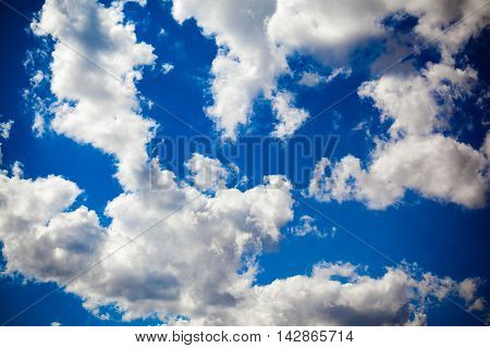 White cumulus clouds on blue sky background