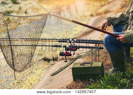 Close up of male hands holding fishing rod