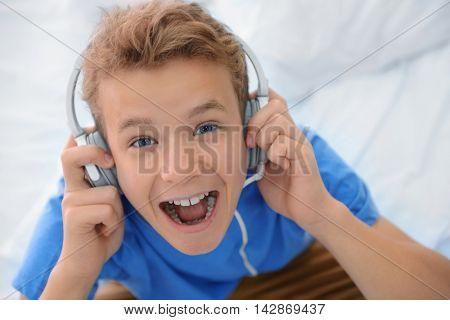 Boy listening music on sofa