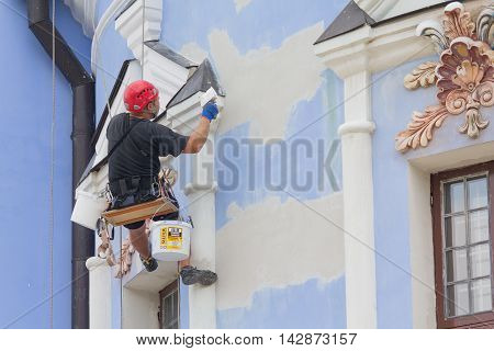 Kiev Ukraine - September 04 2015: Worker-restorer working at height Repair Michael's Monastery