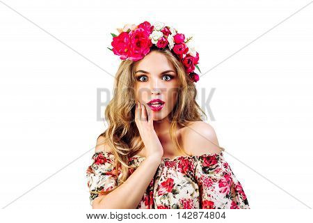 preety young woman ( girl ) in wreath with flowers smiling and surprised on white background