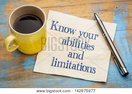 Know your abilities and limitations - handwriting on a napkin with a cup of espresso coffee