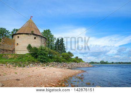 Royal Tower on the banks of the Neva river sunny august day. Oreshek fortress. Leningrad region, Shlisselburg, Russia