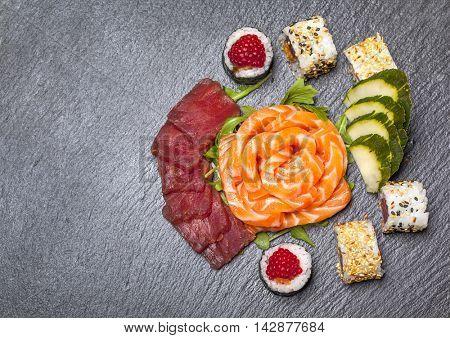 Top view of beautiful sushi arrangement on slate dish