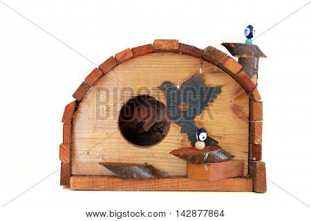 Wooden bird house on a white background