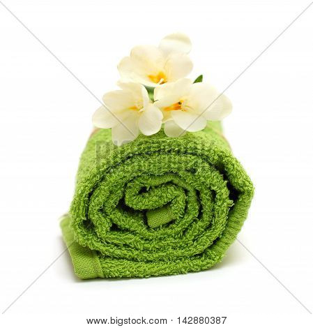 Spa concept - flower and green towel isolated