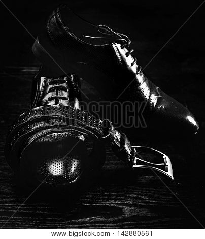 leather men's shoes and belt in blackly white color