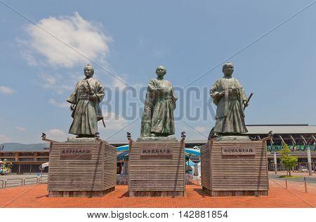KOCHI JAPAN - JULY 19 2016: Statues of leaders of anti-shogun movement of Bakumatsu period near Kochi railway station Japan. Represent Takechi Hanpeita Sakamoto Ryoma and Nakaoka Shintaro