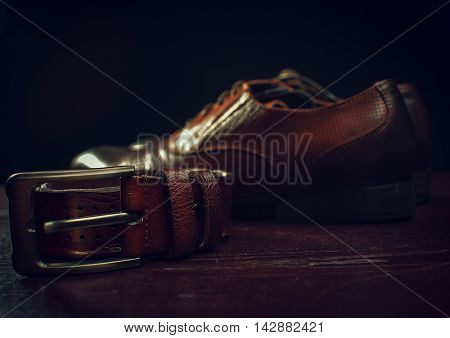 Male accessories. stylish brown shoes and belt