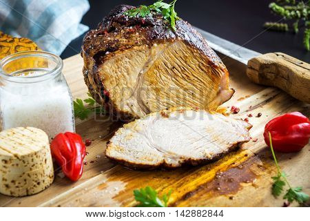 Roasted Pork With Herb On Wooden Background