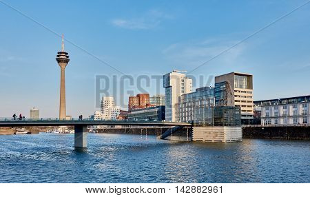 DUESSELDORF, GERMANY - FEBRUARY 27, 2016: view on TV-Tower, marina and famous buildings at new media harbor of Duesseldorf with blue sky and sunny weather