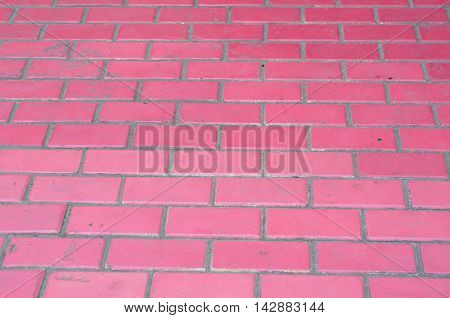 Painted red brick wall with vanishing perspective as background