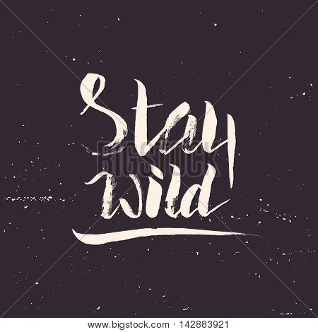 Stay wild. Hand lettering apparel t-shirt print design, typographic composition phrase quote poster
