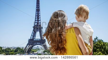 Mother And Child Looking At Eiffel Tower In Paris, France