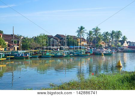 HOI AN, VIETNAM - JANUARY 04, 2016: Early morning on the Thu Bon river. The historic town centre of Hoi An. Historical landmark