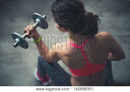 Upper View On Fitness Woman Workout With Dumbbell In Loft Gym