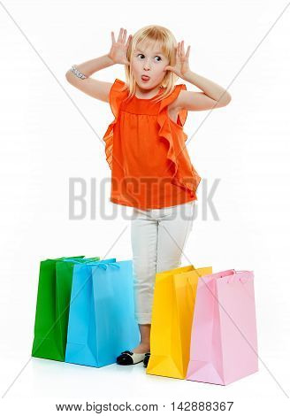 Blond Girl Standing Near Colourful Bags And Act The Ape
