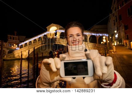 Woman Taking Selfie While Spending Christmas Time In Venice
