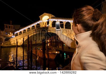 Woman Taking Photo Of Rialto