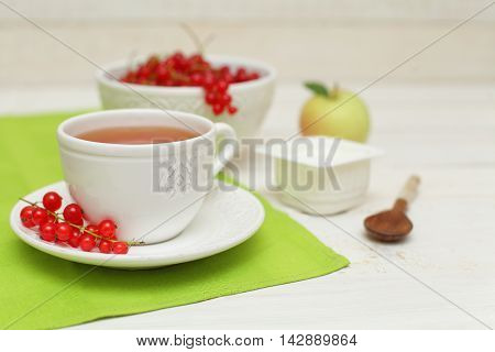 Tea and redcurrant food background (shallow depth of field)