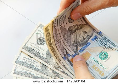 Close up of male hands with money. Dollars