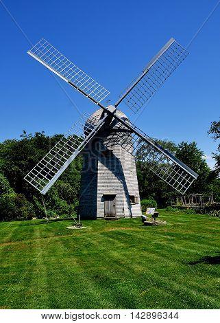 Middletown Rhode Island - July 16 2015: 1812 Robert Sherman shingled smock windmill at the Prescott Farm historic site