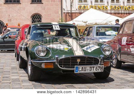 Nurnberg Bavaria / Germany - July 19th 2014: green Jaguar E Type at Sud - Rallye- Historic event in Nurnberg