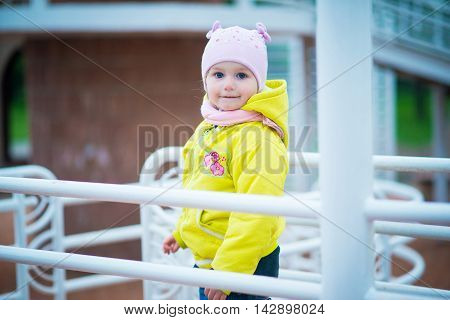 beatiful little girl playing in the park