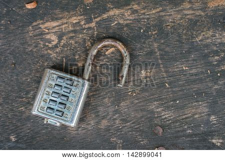 old combination lock on old wooden table